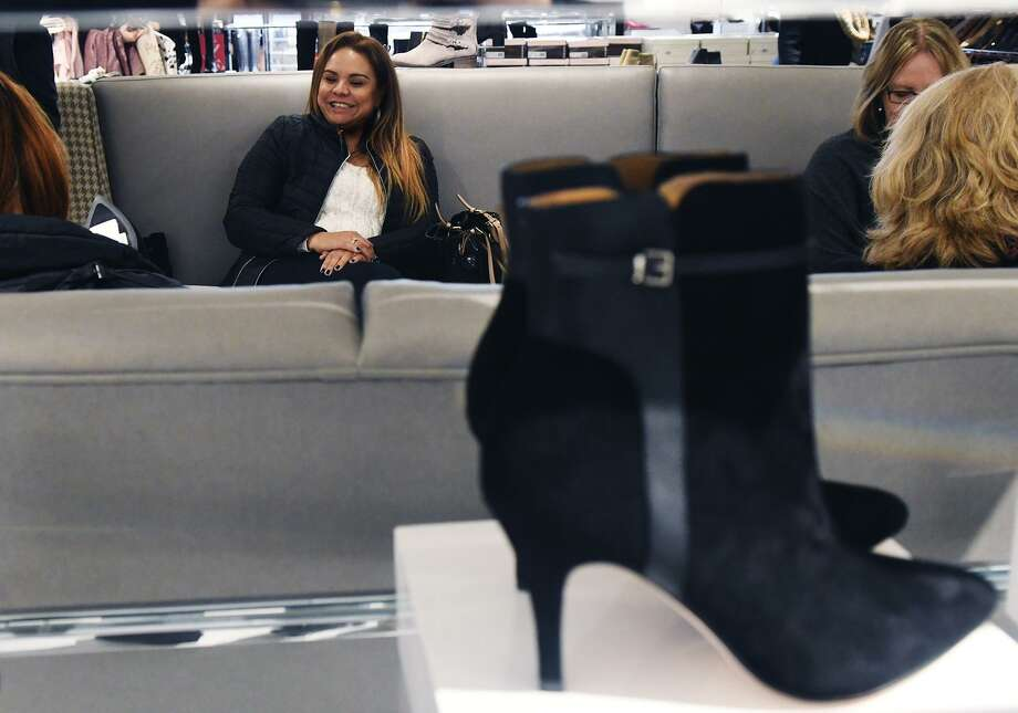 Emileidy Soto amid the shoes in the newly renovated Lord & Taylor in Stamford, Conn., Dec. 1, 2016. Photo: Keelin Daly / For Hearst Connecticut Media / Greenwich Time Freelance