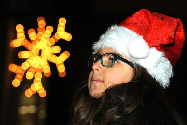 Angelani Serrano, age 8 of Bridgeport, attends the annual tree lighting ceremony on Mclevy Green, in Bridgeport, Conn. Dec. 1, 2016.