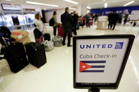 Passengers wait in line to check in for United Flight 1502 for the first direct passenger flight from Newark Liberty International Airport to Havana, Cuba, Tuesday, Nov. 29, 2016, in Newark, N.J. Commercial flights between the United States and Cuba resumed several months ago as relations between the two countries gradually improved under President Barack Obama.  (AP Photo/Julio Cortez)