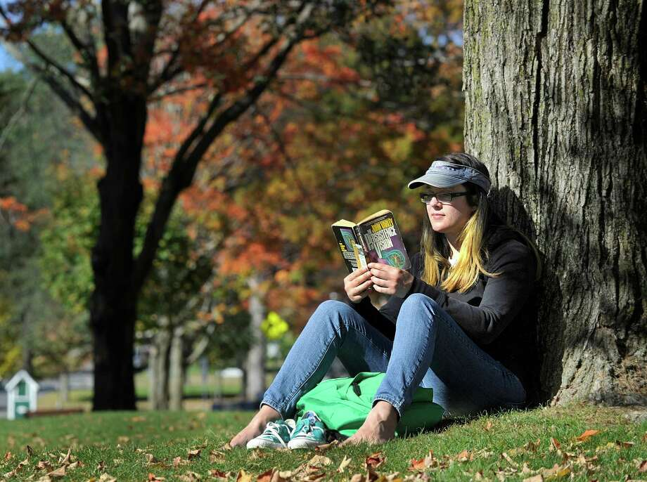 A recent study by a found that reading a book can be more relaxing that listening to music or taking a walk. Photo: Carol Kaliff, Photo Editor / The News-Times
