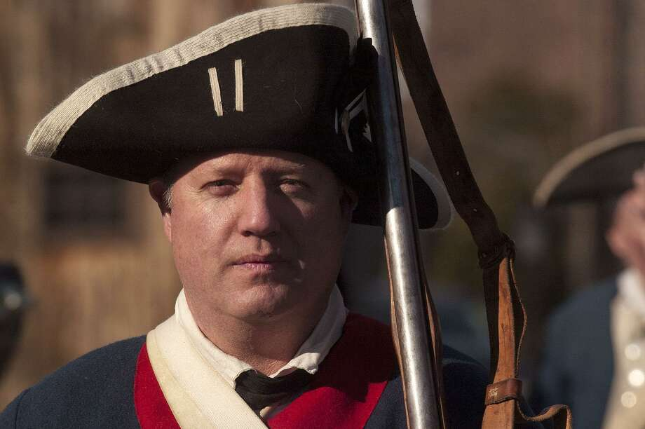File photo of Erik Paul, a reenactor with the 5th Connecticut Regiment, stands at attention during the Putnam Hill Park Rededication and American Revolutionary War Reenactment at Putnam Cottage in Greenwich, Conn., on Sunday, Feb. 22, 2015. Photo: Jason Rearick / Jason Rearick / Stamford Advocate