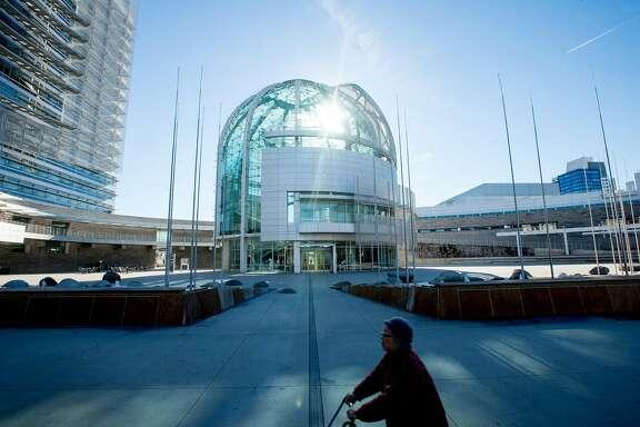 A woman passes San Jose City Hall's rotunda on Friday, Dec. 2, 2016, in San Jose, Calif.