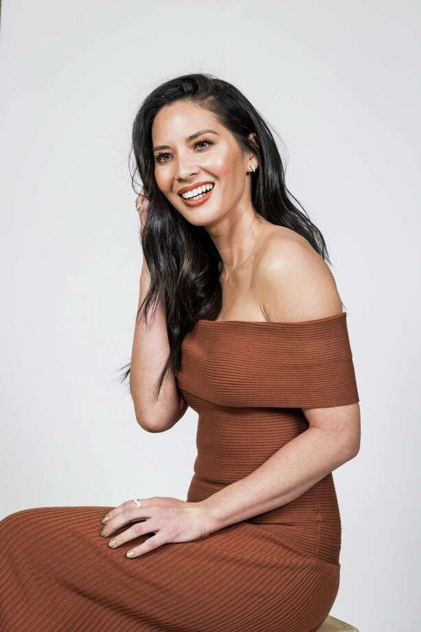 "-- PHOTO MOVED IN ADVANCE AND NOT FOR USE - ONLINE OR IN PRINT - BEFORE NOV. 27, 2016. -- Olivia Munn in Los Angeles, Nov. 19, 2016. In her latest movie, ""Office Christmas Party,"" Munn is the resident brainiac of a struggling IT firm. (Emily Berl/The New York Times) Photo: EMILY BERL, STR / NYTNS"