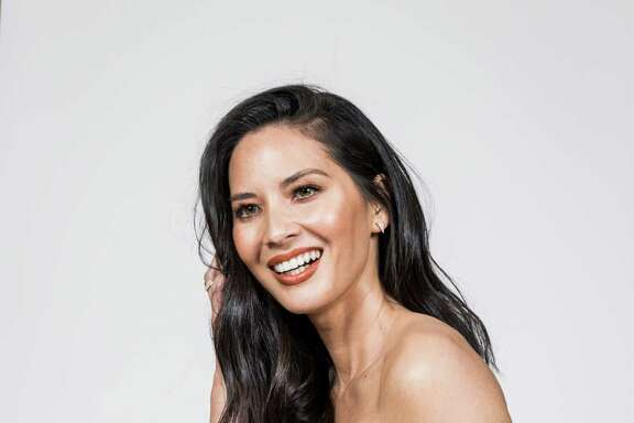 "-- PHOTO MOVED IN ADVANCE AND NOT FOR USE - ONLINE OR IN PRINT - BEFORE NOV. 27, 2016. -- Olivia Munn in Los Angeles, Nov. 19, 2016. In her latest movie, ""Office Christmas Party,"" Munn is the resident brainiac of a struggling IT firm. (Emily Berl/The New York Times)"