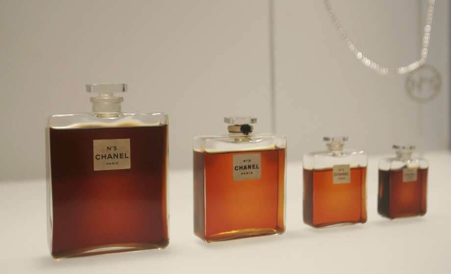 FILE - In this May 2, 2005 file photo, bottles of Chanel No. 5 perfume are displayed at the Metropolitan Museum of Art's Costume Institute exhibit in New York. Chanel is making a stink over a possible high-speed train line through jasmine fields in Provence, warning it could threaten production of its Chanel No. 5 perfume. (AP Photo/Hiroko Masuike, File) Photo: HIROKO MASUIKE, Associated Press