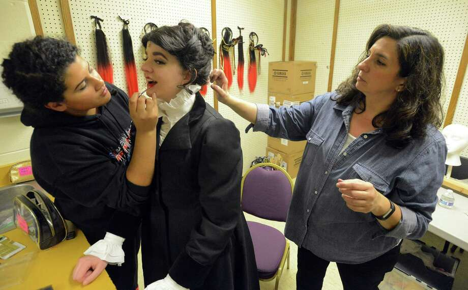 "Monica Gonzalez, a Westhill High School senior in charge of hair and make up, and Donna Isola help Mary Poppins, played by Courtney Kollar, a senior at Trinity Catholic High School, with her make up, hair and wardrobe, as she and the cast for The Stamford All-School Musical of ""Mary Poppins"" prepares for a final full-dress rehearsal Wednesday, Nov. 30, 2016 at the Westhill High School auditorium. Photo: Matthew Brown / Hearst Connecticut Media / Stamford Advocate"