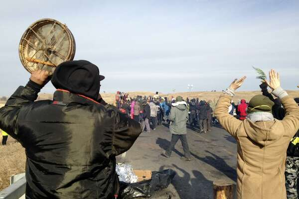 Protesters against the Dakota Access oil pipeline congregate on Nov. 21 near Cannon Ball, N.D., on a long-closed bridge on a state highway near their camp in southern North Dakota.