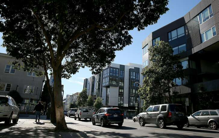 A view of 300 Ivy St. (middle) and 400 Grove St. (right) in Hayes Valley on Friday, December 2, 2016, in San Francisco, Calif.
