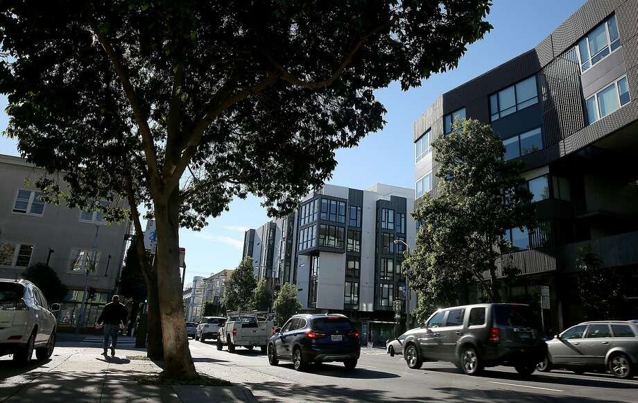 According to the city, 300 Ivy St. (middle) and 400 Grove St. (right) in Hayes Valley are leading examples of well-done projects. Photo: Liz Hafalia, The Chronicle