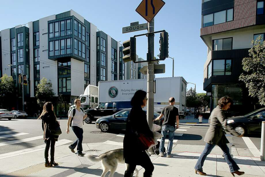 300 Ivy St. (left) and 400 Grove St. (right) in Hayes Valley are praised by the city. Photo: Liz Hafalia, The Chronicle