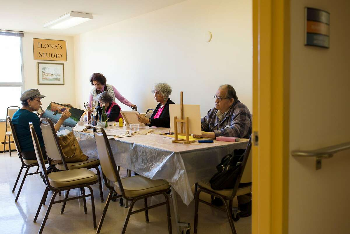 Olinda Marti-Volkoff, a Medicare recipient, (center) works on a painting while taking a class with other seniors at the On Lok 30th Street Senior Center in San Francisco, Calif., on Friday, December 2, 2016. She visits the center almost every weekday for classes and to volunteer. House Speaker Paul Ryan has called for changing Medicare from the current plan, where the government pays the bills, to a defined payment plan, where seniors get a certain amount of money to buy private insurance. Studies have shown that likely means higher costs and less coverage for seniors.