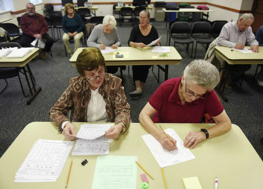 Carol Sabato, left, of Greenwich, and Cathy Lesta, of Glenville, work together to tally ballots during a state-mandated audit of Greenwich's District 2 presidential election ballots at Town Hall in Greenwich, Conn. Thursday, Dec. 1, 2016. The audit is a test to see how the optical scanner machines performed and is not expected to find any major errors. Photo: Tyler Sizemore / Hearst Connecticut Media / Greenwich Time