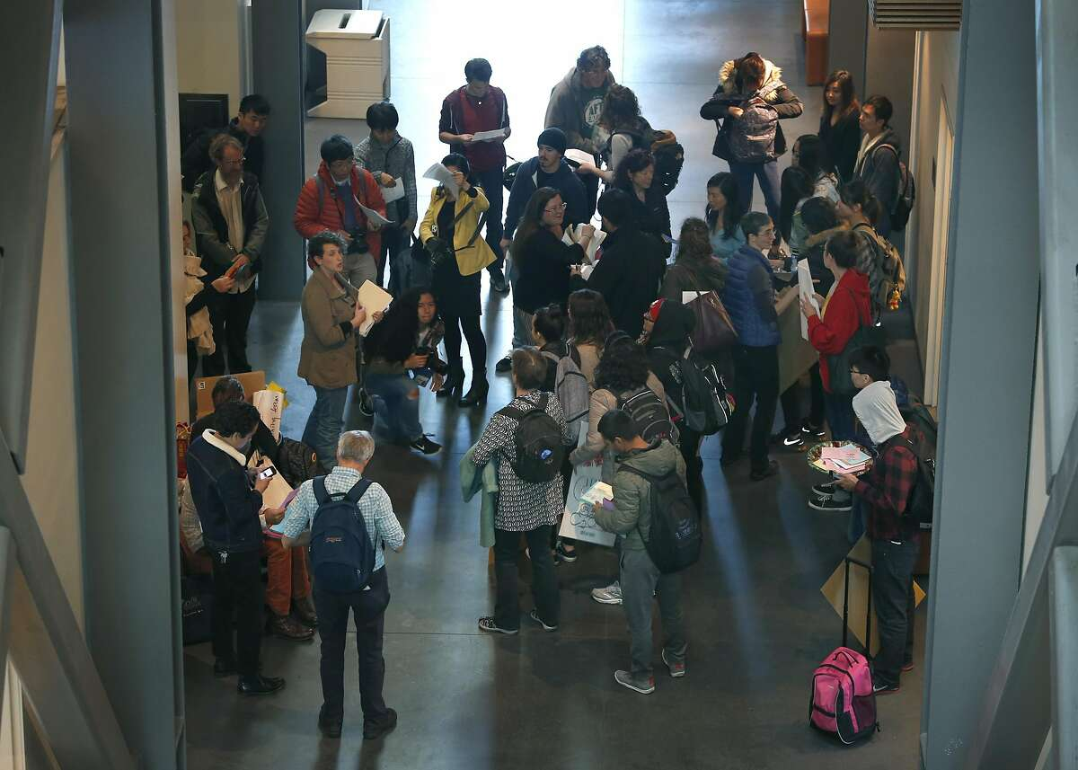 Students and faculty members, upset by an accelerated plan for cutbacks at City College, prepare to disrupt a monthly closed-door meeting between interim Chancellor Susan Lamb and school administrators in San Francisco, Calif. on Friday, Dec. 2, 2016. Lamb called an abrupt halt to the session when the demonstrators refused to leave.
