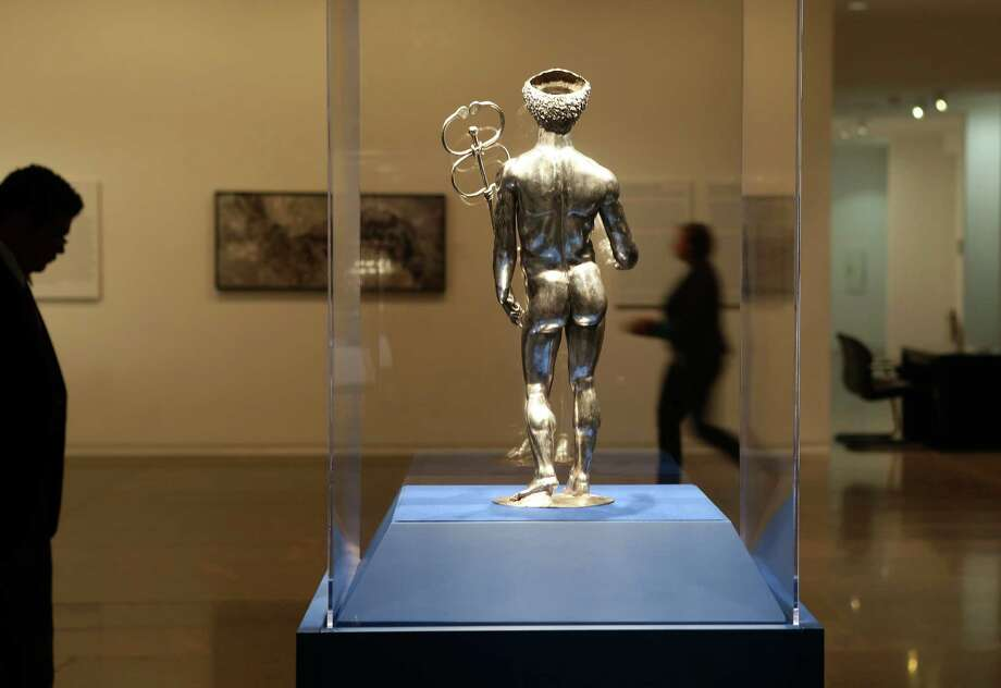 """A silver and gold statue of Mercury created between A.D. 175 - 225 greets visitors to the exhibition """"Ancient Luxury and the Roman Silver Treasure from Berthouville"""" currently on display at the Museum of Fine Arts Houston, Wednesday, Nov. 30, 2016. ( Mark Mulligan / Houston Chronicle ) Photo: Mark Mulligan, Staff / © 2016 Houston Chronicle"""