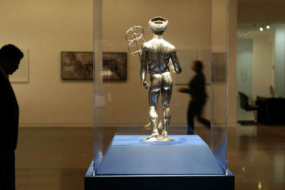 "A silver and gold statue of Mercury created between A.D. 175 - 225 greets visitors to the exhibition ""Ancient Luxury and the Roman Silver Treasure from Berthouville"" currently on display at the Museum of Fine Arts Houston, Wednesday, Nov. 30, 2016. ( Mark Mulligan / Houston Chronicle )"