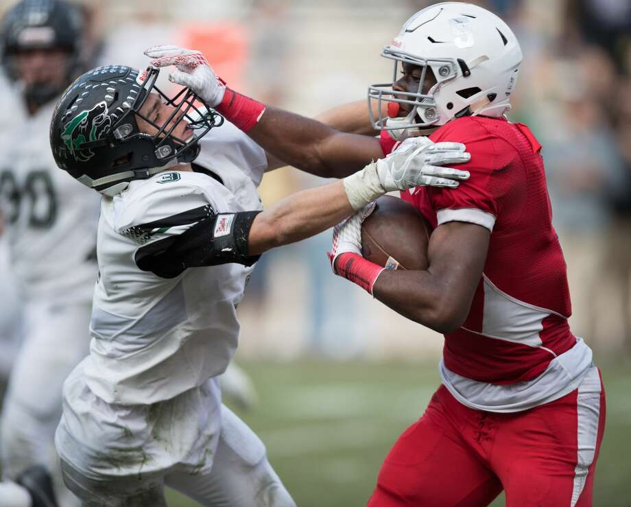 Jalen Preston (5) of the Manvel Mavericks stiff arms Hunter Valk (3) of the Cedar Park Timberwolves in the second half of a high school football Class 5A, Division 1 Regional Semifinal game on Saturday, November 26, 2016 at Kyle Field in College Station Texas. Photo: Wilf Thorne/For The Chronicle