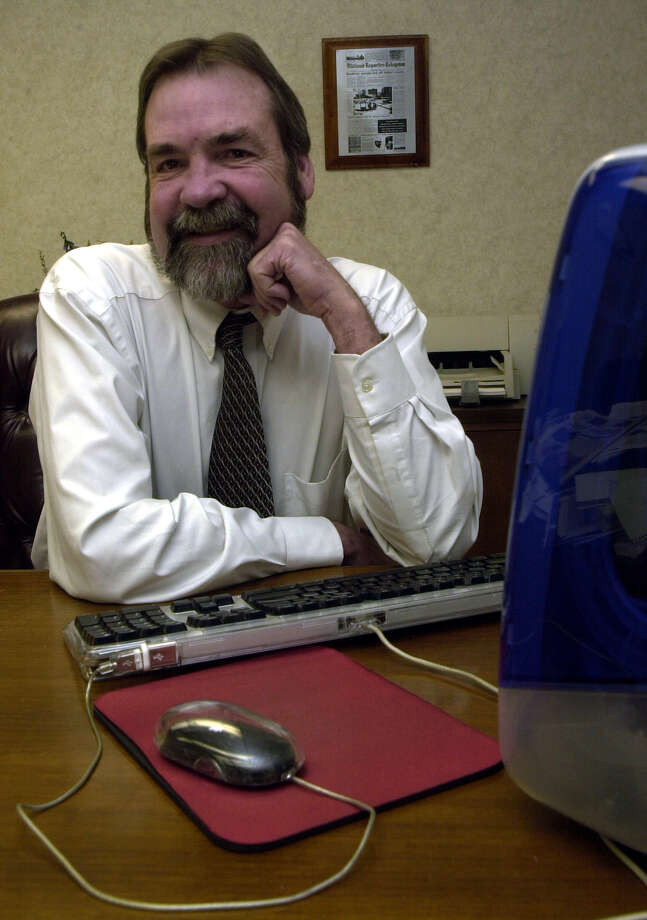 Gary Ott poses at his desk when he was editor of the Reporter-Telegram. Ott died last month in Midland, He was 64.   (File photo) Photo: Midland Reporter-Telegram