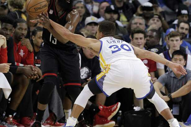 James Harden (13) draws the foul on Stephen Curry (30) during the first half as the Golden State Warriors played the Houston Rockets at Oracle Arena in Oakland, Calif., on Thursday, December 1, 2016.