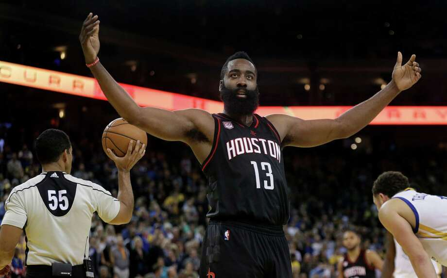 Houston Rockets' James Harden (13) gestures to fans during the second half of an NBA basketball game against the Golden State Warriors Thursday, Dec. 1, 2016, in Oakland, Calif. Houston won 132-127 in double overtime. (AP Photo/Ben Margot) Photo: Ben Margot, STF / AP