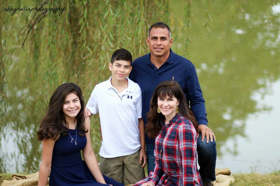 The Fernandez family -- Emily, 14, Aidan, 12 and their parents, Israel and  Liz -- spends a lot of time traveling to the children's sports competitions. Emily competes in jiujitsu and Aidan in club soccer. Photo: Courtesy Photo