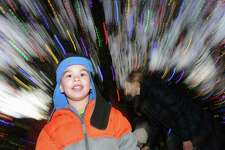 Sebastian Ali, 4, of Greenwich during the Town of Greenwich annual Tree Lighting Ceremony in front of Greenwich Town Hall, Conn., Friday, Dec. 2, 2016. Town Tree Warden Bruce Spaman said the 30 foot high Norway spruce tree was decorated with strings of multi-colored holiday lights measuring around 600 feet.