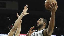 LaMarcus Aldridge gets off a shot against Anthony Davis as the Spurs host the Pelicans at the AT&T Center on Oct. 29, 2016. Aramark Sports and Entertainment, the arena's concessions contractor, made more than $391,000 in alcohol sales in October.