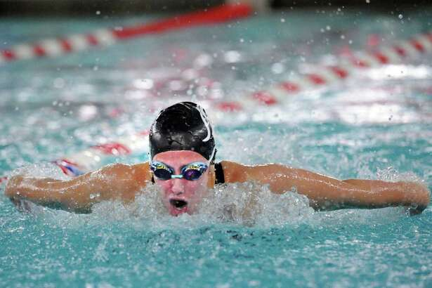 Erika Ehret of Westhill/Stamford competes in the 100 butterfly event during the FCIAC Girls Swimming Championship at Greenwich High School, Conn., Thursday, Nov. 3, 2016.