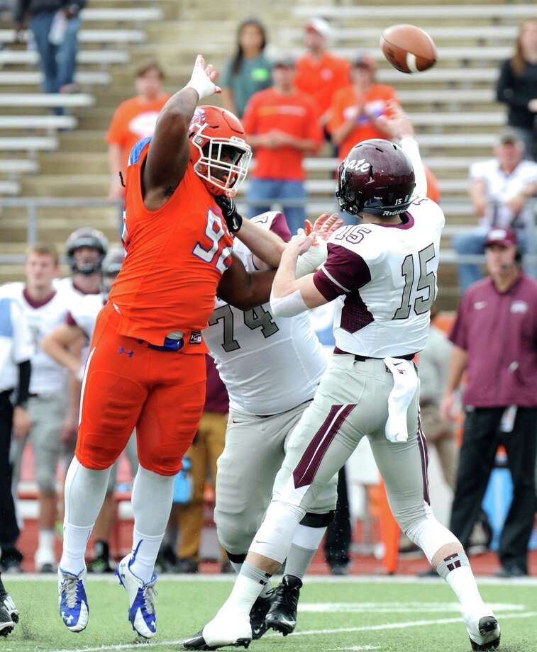 Colgate quarterback Jake Melville (15) throws under pressure from Sam Houston State defensive end P.J. Hall during the first half of an NCAA college football game in the quarterfinals of the Football Championship subdivision, Saturday, Dec. 12, 2015, in Huntsville, Texas. (Joshua Yates /The Huntsville Item via AP) MANDATORY CREDIT (REV-SHARE) Photo: Joshua Yates, Associated Press / The Huntsville Item