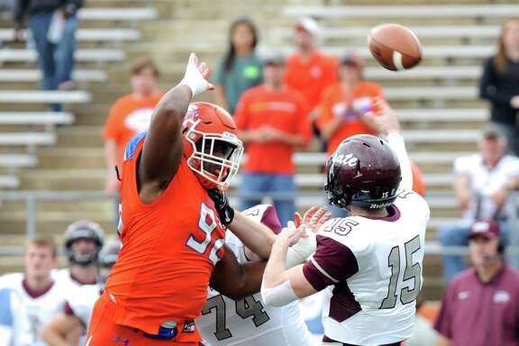 Colgate quarterback Jake Melville (15) throws under pressure from Sam Houston State defensive end P.J. Hall during the first half of an NCAA college football game in the quarterfinals of the Football Championship subdivision, Saturday, Dec. 12, 2015, in Huntsville, Texas. (Joshua Yates /The Huntsville Item via AP) MANDATORY CREDIT (REV-SHARE)