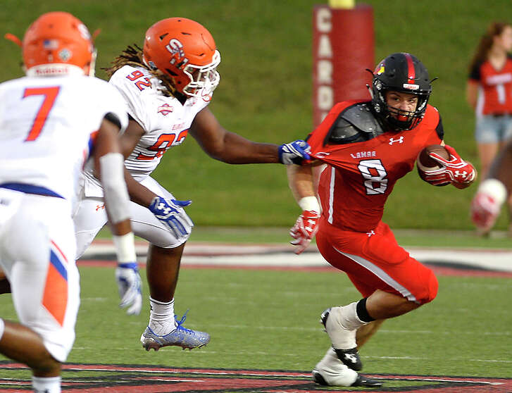 Lamar's Kade Harrington is snagged for the tackle by Sam Houston State's P. J. Hall during Saturday's conference game at Provost-Umphrey Stadium. Photo taken Saturday, September 17, 2016 Kim Brent/The Enterprise