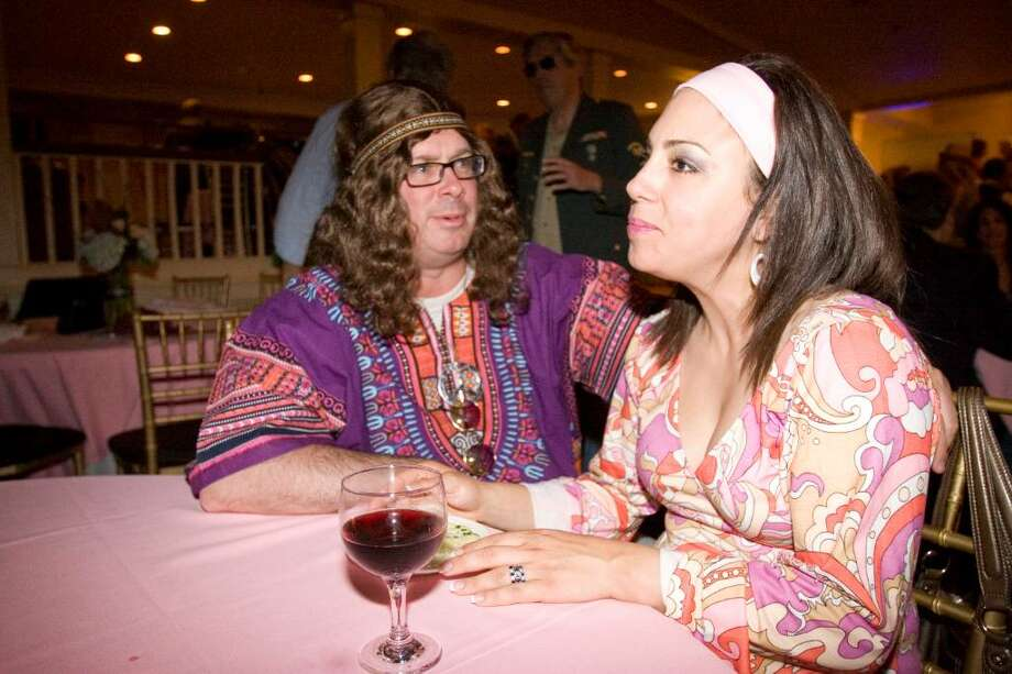 Lisa Thygrson, right, and husband John Thygrson, left, at the Longshore Club Park 50th anniversary celebration at the Inn at Longshore on Thursday, May 20, 2010. Lisa and John won Best Costume during the evening. Photo: Laura Buckman / Connecticut Post