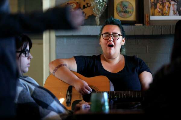 Sam Hernandez leads worship during a staff prayer meeting at Pendleton Farms on Monday, Nov. 21, 2016, in Kendleton, TX. A Christian organization called Elijah Rising owns and runs the farm in hopes of providing a refuge for human trafficking victims. (Annie Mulligan / Freelance)