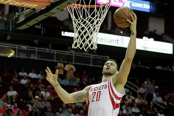 Houston Rockets forward Donatas Motiejunas makes a basket during the first half of NBA game action at the Toyota Center Sunday, April 10, 2016, in Pearland.