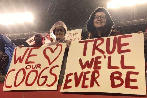 Fans watch as UH football practices in the rain at TDECU Stadium, Dec. 2, 2016.