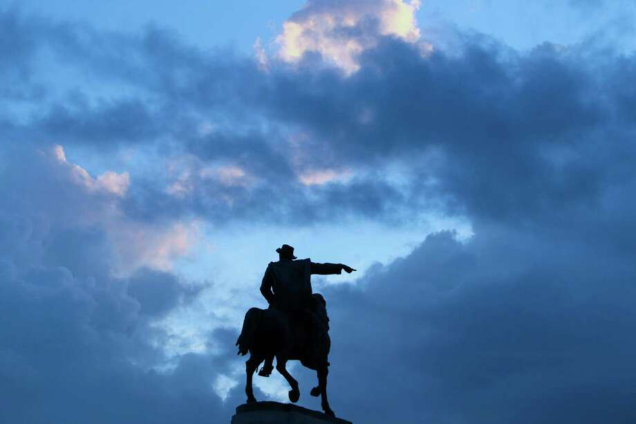The statue of Gen. Sam Houston at Hermann Park seems to point to a opening in the clouds. ( Steve Gonzales  / Houston Chronicle ) Photo: Steve Gonzales, Staff / © 2016 Houston Chronicle