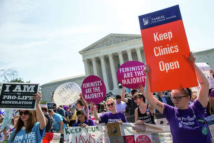 Demonstrations outside the Supreme Court in Washington as a challenge to Texas state regulations regarding abortion clinics was heard, June 27, 2016. In a rule finalized on Nov. 28, Texas has required that abortion service providers pay for the cremation or burial of fetal remains - a latest attempt to make it harder for them to remain in business. (Photo by Al Drago/The New York Times)