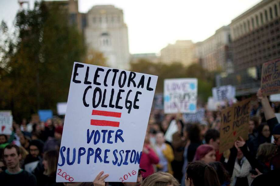 Protestors demonstrate against President-elect Donald Trump outside Independence Hall Nov. 13, 2016 in Philadelphia. The Republican candidate lost the popular vote by more than a million votes, but won the electoral college.  (Photo by Mark Makela/Getty Images) Photo: Mark Makela, Stringer / 2016 Getty Images
