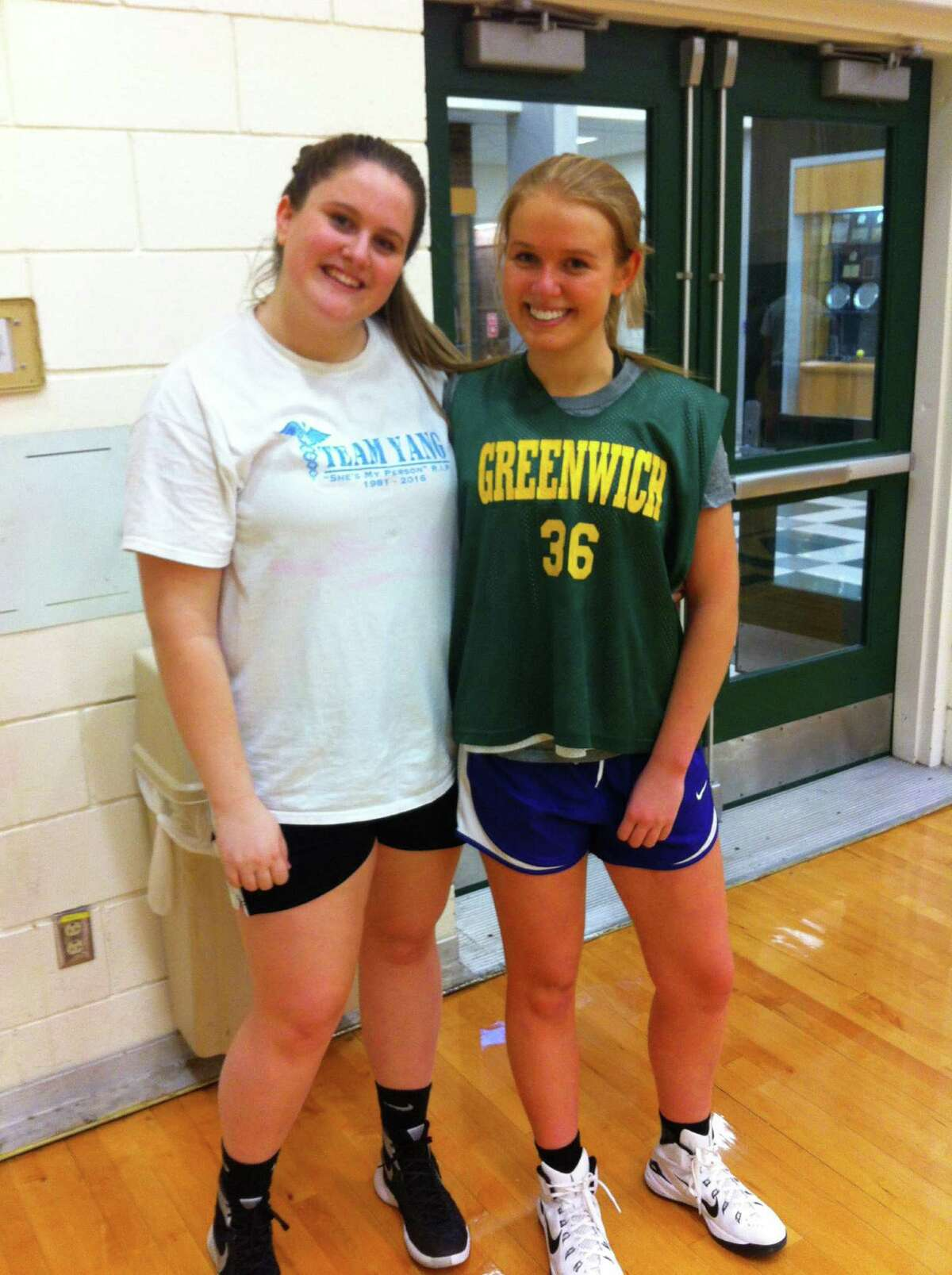 Alice Hudson, left, and Brooke Powers are captains of the Greenwich Academy basketball team. Dec. 2, 2016