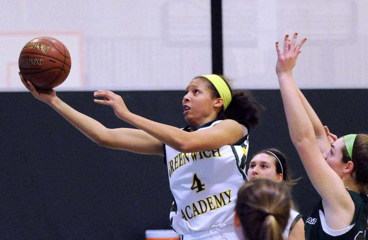 At left, Kaitlyn Davis (#4) of Greenwich Academy beats a group of Convent defenders to score on a lay-up during the girls high school basketball game between Greenwich Academy and Convent of the Sacred Heart at Convent in Greenwich, Conn., Wednesday, Dec. 16, 2015.