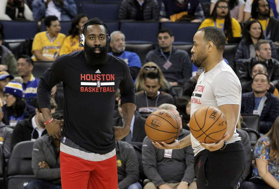 Rockets assistant coach Irving Roland, right, works with James Harden (13) before the Houston Rockets played the Golden State Warriors at Oracle Arena in Oakland, Calif., on Thursday, December 1, 2016. Photo: Carlos Avila Gonzalez, The Chronicle