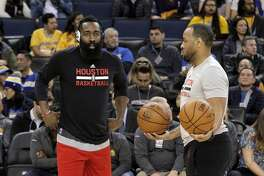Rockets assistant coach Irving Roland, right, works with James Harden (13) before the Houston Rockets played the Golden State Warriors at Oracle Arena in Oakland, Calif., on Thursday, December 1, 2016.