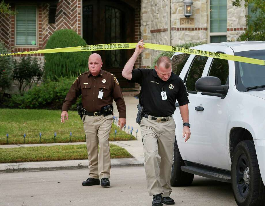 Fort Bend County Sheriff Troy Nehls, right, said a Katy-area woman told 911 calltakers that she shot her husband. The woman is cooperating with authorities investigating the man's death, he added. Photo: Jon Shapley, Staff / © 2015  Houston Chronicle