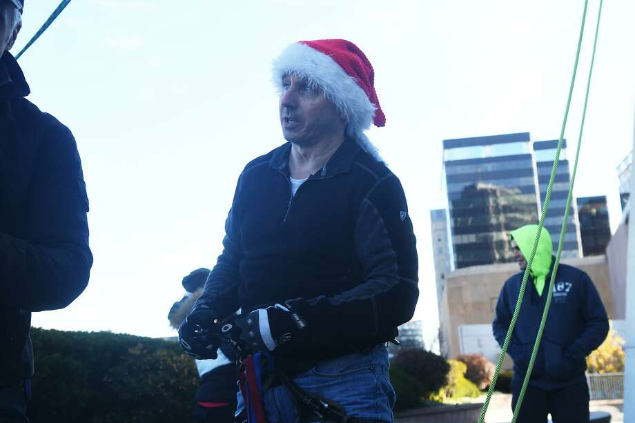 Brian Cashman, General Manager for the Yankees, rehearses for the DSSD's annual Rappelling Santa and Holiday Tree Lighting event with a practice run from the top of the Landmark Square building in Stamford, Conn., Dec. 2, 2016. Cashman has been filling the role of Santa for five years, starting with the rappel from one of the state's tallest building followed by a parade to Lapham Park and a tree lighting ceremony. The event will take place Sunday, Dec. 8 at 5 PM. Photo: Keelin Daly / For Hearst Connecticut Media / Greenwich Time Freelance