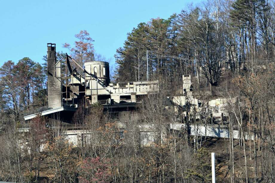 The burnt remains of a home known to visitors as The Castle is seen from downtown Gatlinburg, Tenn., Friday, Dec. 2, 2016. Residents were getting their first look at what remains of their homes and businesses in Gatlinburg, after a wildfire tore through the resort community on Monday, Nov. 28. (Michael Patrick/Knoxville News Sentinel via AP) Photo: Michael Patrick, MBO / ©2016