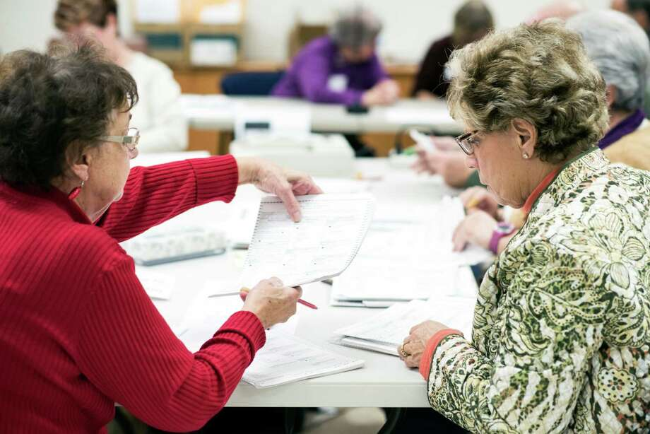 Ballots are checked Friday during a recount of the presidential election at the Walworth County Government Center in Elkhorn, Wis. Photo: LAUREN JUSTICE, STR / NYTNS
