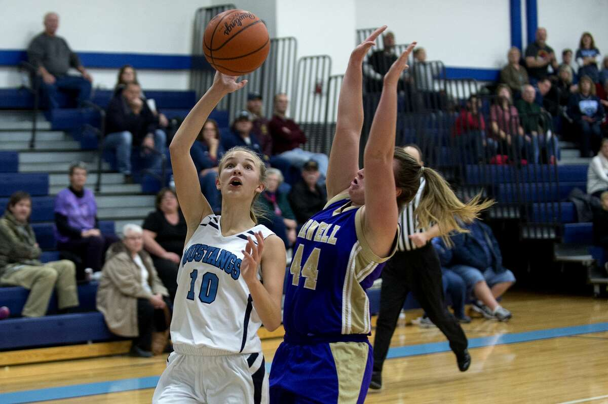 Meridian's Camryn McKellar prepares to shoot a lay-up while Farwell's Lillian Albaugh guards her in the first half of Friday's game.