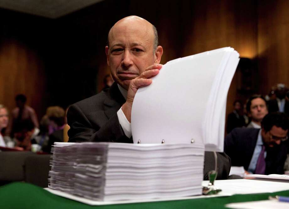Goldman Sachs CEO Lloyd Blankfein prepares for his Senate testimony in 2010. The bank's public standing was battered after the 2008 financial crisis. Photo: Evan Vucci, STF / AP