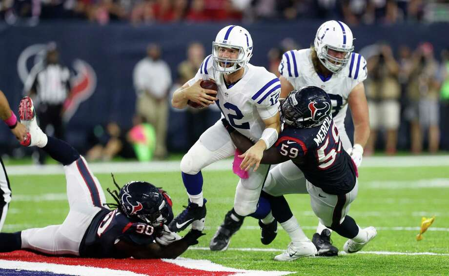 Indianapolis Colts quarterback Andrew Luck (12) is sacked by Houston Texans outside linebacker Whitney Mercilus (59) and defensive end Jadeveon Clowney (90) during the third quarter of an NFL football game at NRG Stadium, Sunday,Oct. 16, 2016 in Houston.   ( Karen Warren / Houston Chronicle ) Photo: Karen Warren, Staff Photographer / 2016 Houston Chronicle