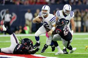 Indianapolis Colts quarterback Andrew Luck (12) is sacked by Houston Texans outside linebacker Whitney Mercilus (59) and defensive end Jadeveon Clowney (90) during the third quarter of an NFL football game at NRG Stadium, Sunday,Oct. 16, 2016 in Houston.   ( Karen Warren / Houston Chronicle )