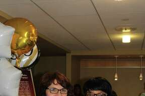 Thelma Williams, at right, the first employee to celebrate 50 years of working at Saratoga Hospital, is congratulated Thursday Dec. 1, 2016, by Marcy Dreimiller, associate vice president human resources. (Submitted photo)